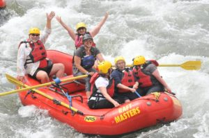 People in a raft on the Arkansas River having a blast