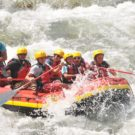 guests on raft navigating rapids on the Arkansas river Raft Masters Tours Colorado
