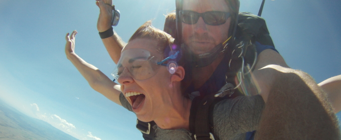Breanna screaming with joy while skydiving Raft Masters Tours Colorado