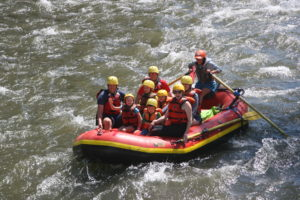 A family having fun White Water Rafting in Colorado Springs