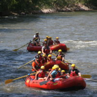 three rafts with families going down the river Raft Masters Colorado