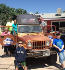 Guests including adults and children enjoying a jeep tour Raft Masters Colorado