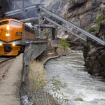 oncoming Royal Gorge train on tracks near river Raft Masters Colorado tour