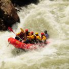 guests in raft in the middle of crazy rapids on Clear Creek Raft Masters Tours Colorado
