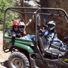Driver and two small children in an ATV Raft Masters Tours Colorado