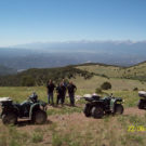 View of the mountains with people and ATVs Raft Masters Tours Colorado