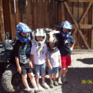 four young children wearing helmets in front of an ATV Raft Masters Tours Colorado