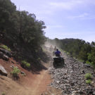People on ATVs going up a rocky path Raft Masters Tours Colorado