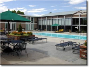 Quality Inn Hotel Canon City outdoor pool and guest room