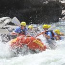 guests on raft having fun navigating rapids on the Arkansas river Raft Masters Tours Colorado