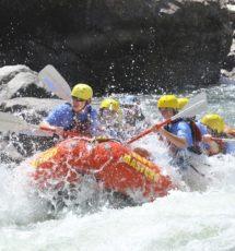 guests on raft having fun navigating rapids on the Arkansas river Raft Masters Tours Colorado