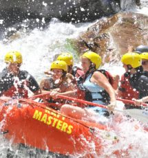 Water splashing on guests in a raft on the Arkansas river Raft Masters Colorado