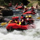 guests in rafts going through rapids on Clear Creek Raft Masters Tours Colorado