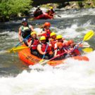 guests in raft going into rapids on Clear Creek with another raft in background Raft Masters Tours Colorado