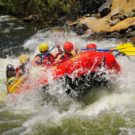 Raft getting sprayed by water in rapids on Clear Creek Raft Masters Tours Colorado