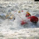 raft getting sprayed with water from rapids on Clear Creek Raft Masters Tours Colorado