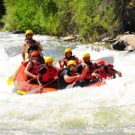 guests in raft going through rapids on Clear Creek Raft Masters Tours Colorado