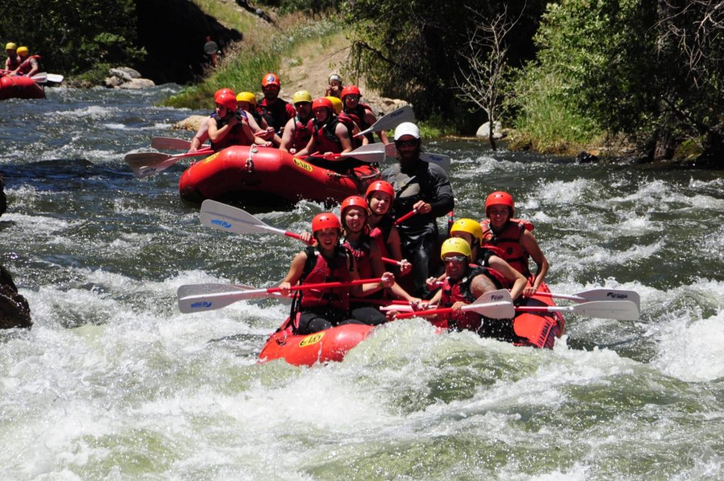 Two rafts full of people starting into rapids on Clear Creek