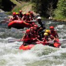 Two rafts full of guests starting into rapids on Clear Creek Raft Masters Tours Colorado