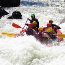 guests in raft about to head into rapids on Clear Creek Raft Masters Tours Colorado