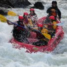 guests in raft on Clear Creek getting sprayed by water from rapids Raft Masters Tours Colorado