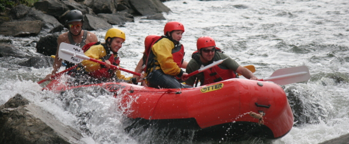 guests in raft navigating past rocks on Clear Creek Raft Masters Tours Colorado