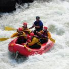 small group of guests in raft navigating through rapids on Clear Creek Raft Masters Tours Colorado