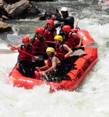 guests in raft navigating through rapids on Clear Creek Raft Masters Tours Colorado