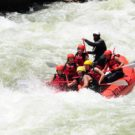 guests in raft going into rapids on Clear Creek Raft Masters Tours Colorado