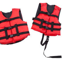 Red and black children's life jackets isolated on white